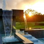fountain with sunset it background